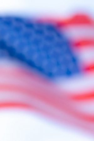 wavy-blurred-focus-united-states-america-flag-with-white-background_50039-708.jpg