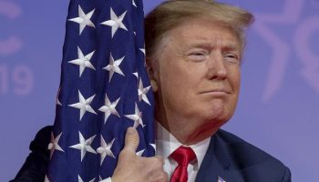 Donald-Trump-with-US-Flag.jpg